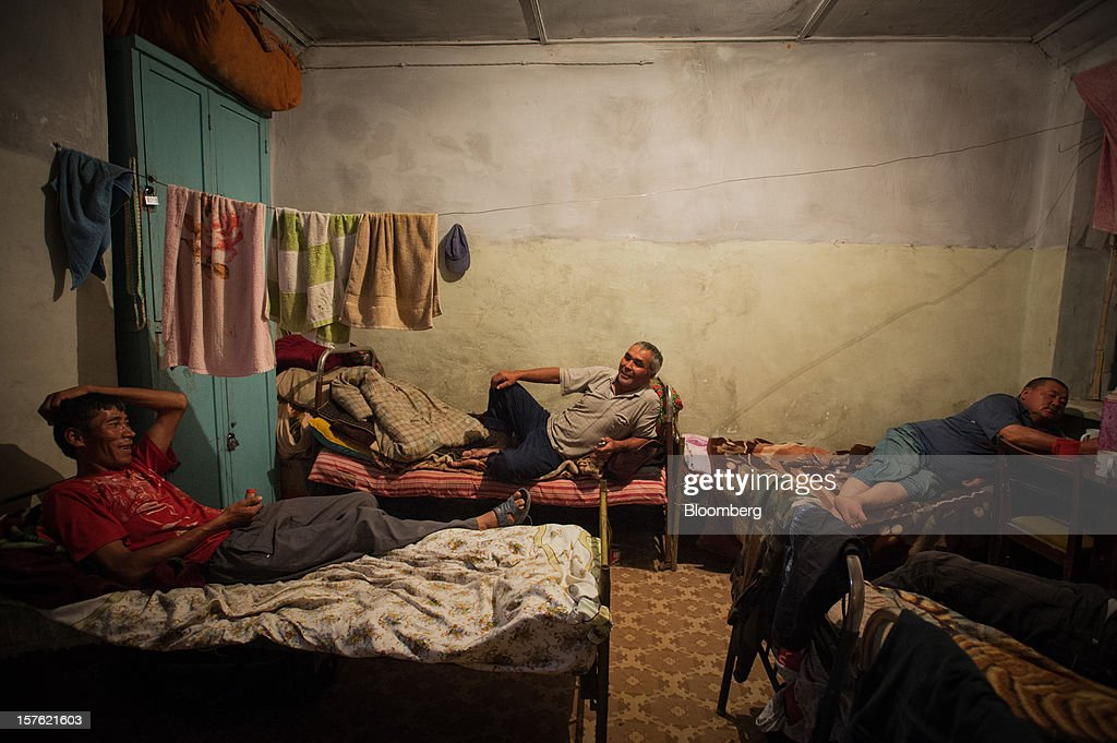 Workers of the relocation project for radioactive mining waste tailings dump No. 3 relax on their beds in a dormitory during their lunch break in Mailuu-Suu, Jalal-Abad, Kyrgyzstan, on Wednesday, Aug. 8, 2012. There are 23 tailing dumps and 13 waste rock dumps around Mailuu-Suu due to a uranium plant that processed more than 10,000 metric tons of uranium ore products from 1946 to 1968. Photographer: Noriko Hayashi/Bloomberg via Getty Images