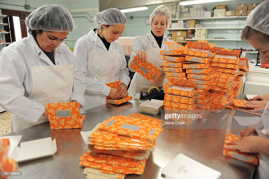 Workers of the Santo Tome Obrador de Mazapan bakery package traditional almond-based mazapan cakes on November 29, 2012 in Toledo, Spain. The company, which employs 45 staff throughout the year, has hired an extra 25 workers leading up to the christmas festivities hoping comsumption picks up over the holiday period.