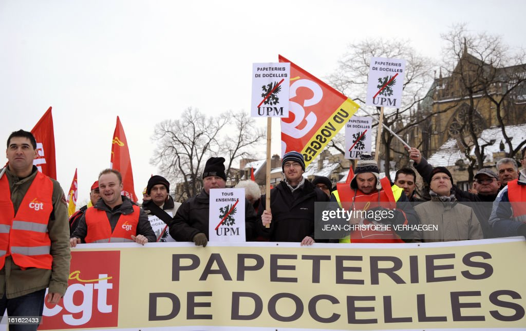 Workers of the 'UPM Papeteries de Docelles' stationery factory take part in a demonstration called by French CGT trade union on February 13, 2013 in Metz, eastern France, to claim for the safeguard of the local industry in the French eastern region of Lorraine.