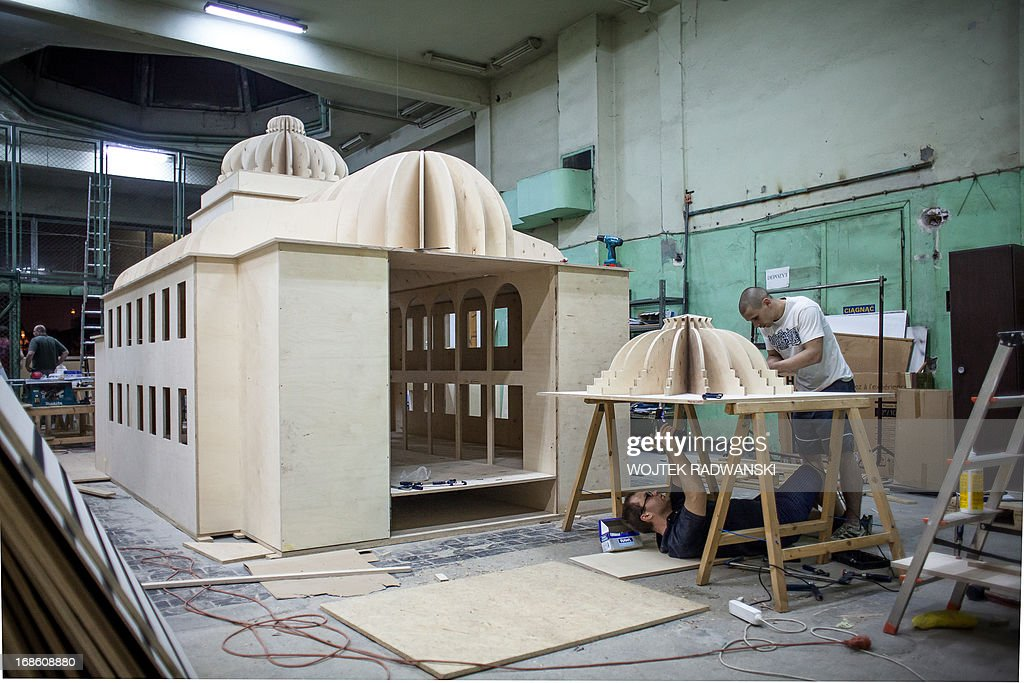 Workers of Tryktrak carpentry workshop are finishing a 1:10 scale model of the largest synagogue in pre-war Warsaw, Great Synagogue in Warsaw, on May 12, 2013. The model will be installed on the place near the original location, on May 16, 2013 - 70 years after it was destroyed during World War II Warsaw Ghetto liquidation.