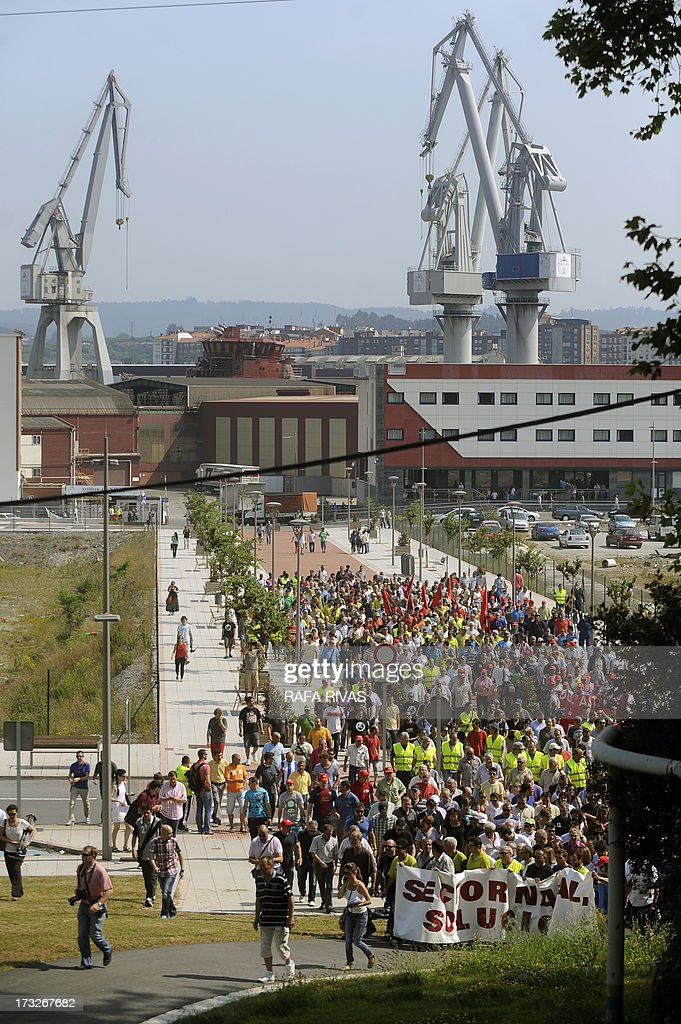 Workers of Zamakona and La Naval shipyards hold a banner reading 'Shipyards, solution' as they take part in a protest against the repayment of state aids by Spanish shipbuilders in the Northern Spanish Basque village of Sestao, on July 11, 2013. Brussels will decide by July 17 if the roughly three billion euros (4.0 billion USD) in state aid which Spanish shipbuilders received between 2005 and 2011 were unauthorised and if they will have to pay the money back. Unions have called for a day of protest and strikes on July 11 when European Union's commissioner for competition, Joaquin Almunia, will meet with representatives of Spanish shipbuilders in Brussels.