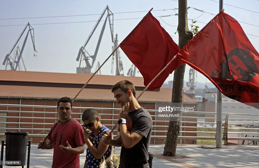 Workers of Zamakona and La Naval shipyards holding a red flag with Che Guevara take part in a protest against the repayment of state aids by Spanish shipbuilders in the Northern Spanish Basque village of Sestao, on July 11, 2013. Brussels will decide by July 17 if the roughly three billion euros (4.0 billion USD) in state aid which Spanish shipbuilders received between 2005 and 2011 were unauthorised and if they will have to pay the money back. Unions have called for a day of protest and strikes on July 11 when European Union's commissioner for competition, Joaquin Almunia, will meet with representatives of Spanish shipbuilders in Brussels.
