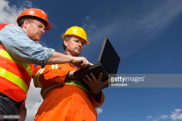 Workers on a Computer
