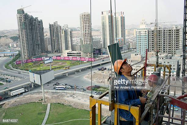 Workers on a construction site in Lanzhou.