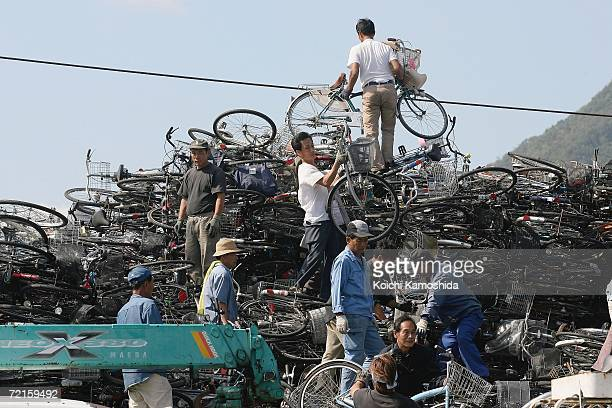 Workers on a North Korean ship pack a cargo of used bicycles and refrigerators at the Maizuru Port October 13 2006 in Maizuru Japan The Japanese...