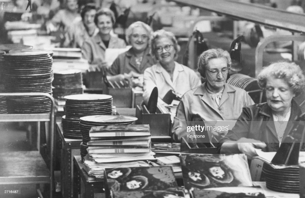Workers on a production line in the EMI factory at Hayes, Middlesex, where the Beatles' new album 'Rubber Soul' is in the final stages of production.
