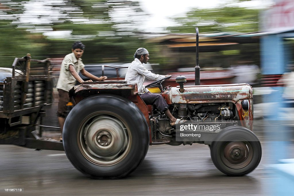 Workers on a tractor travel along a road beside the Wockhardt Ltd. manufacturing facility in the Chikalthana industrial area in Aurangabad, India, on Monday, Sept. 16, 2013. Wockhardt currently controls about 26 percent of the U.S. market for metoprolol, a generic version of the heart pill sold by London-based AstraZeneca Plc under the brand name Toprol-XL, according to Needham & Co. Metoprolol alone makes up about 14 percent of the company's 56 billion rupees in annual revenue. Photographer: Dhiraj Singh/Bloomberg via Getty Images