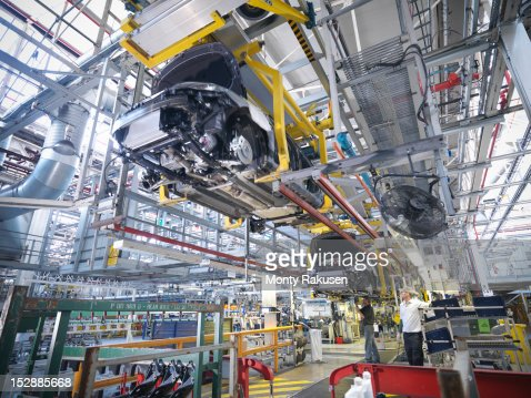 Workers on car production line in car factory