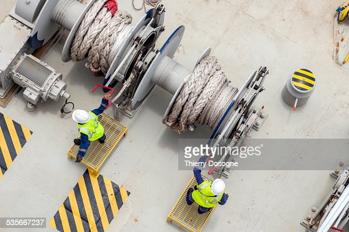 Workers on container ship