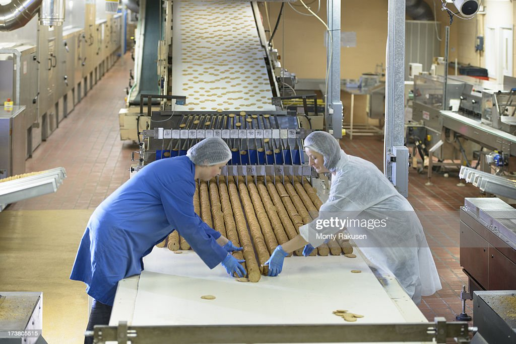 Workers on packing line in biscuit factory
