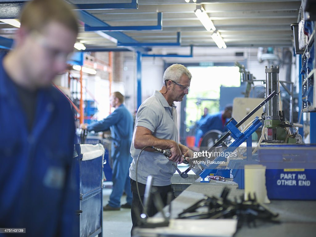 Workers on production line in factory