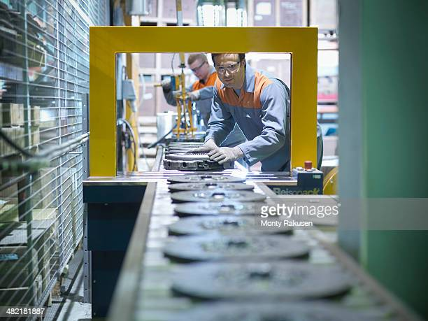 Workers on production line in industrial clutch factory