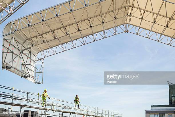 Workers on scaffolding at construction site
