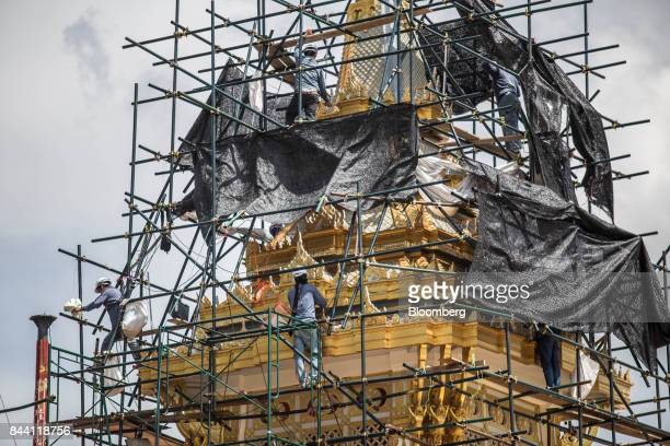 Workers on scaffolding prepare the ceremonial ground for King Bhumibol Adulyadej's cremation at Sanam Luang park in Bangkok Thailand on Friday Sept 8...