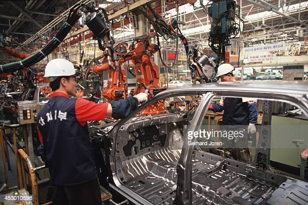 Workers on the assembly line for the Elantra model at the Hyundai Motor Company in Ulsan