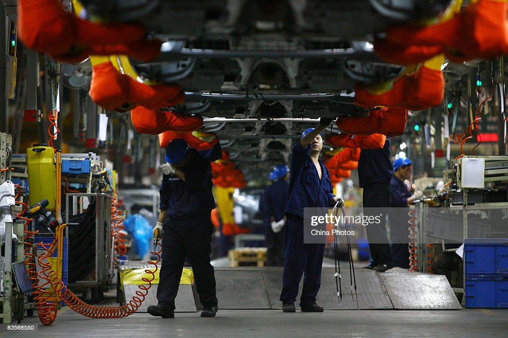 Workers on the Ford S-MAX product line at Chongqing Changan Ford Automobile Co factory on November 5, 2008 in Chongqing, China. The financial crisis has hit the global auto industry, with car sales in the European and American countries dropping severely, which also affects China's auto business. China exported only 44,400 cars overseas in August, a decline of 22.18 percent month-on-month and 11.29 percent year-on-year.