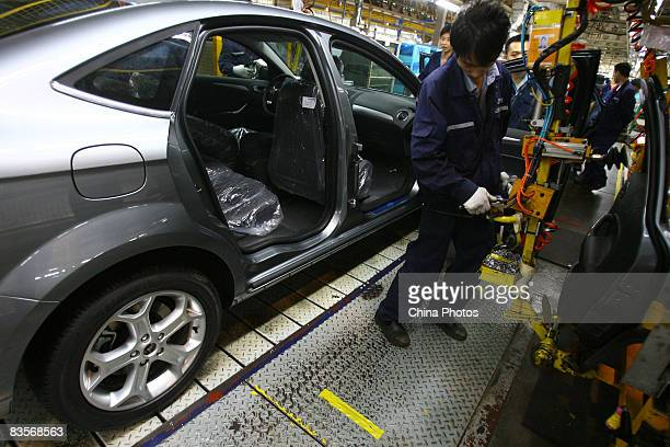 Workers on the Ford SMAX product line at Chongqing Changan Ford Automobile Co factory on November 5 2008 in Chongqing China The financial crisis has...
