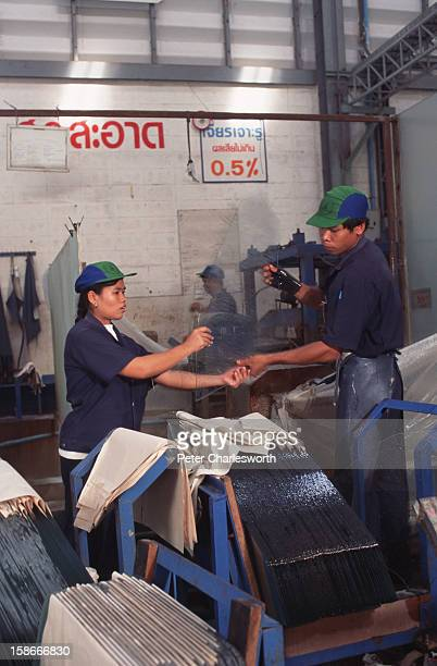 Workers on the production line at the Siam VMC Safety Glass Company The company specialises in manufacturing windows including windscreens for many...