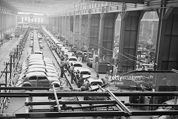 Workers on the production line at the Volkswagen factory at Wolfsburg Germany Original Publication Picture Post 4854 The Two Germanys A Warning pub...