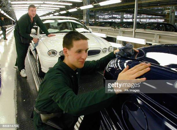 Workers on the production line of the new Jaguar XType at a photocall to mark the official opening of the Halewood Manufacturing Plant in Liverpool...