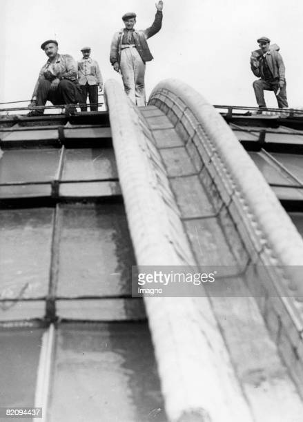 Workers on the roof of the Grand Palais in Paris Photograph France Around 1935 [Arbeiter auf dem Dach des Grand Palais in Paris Frankreich...