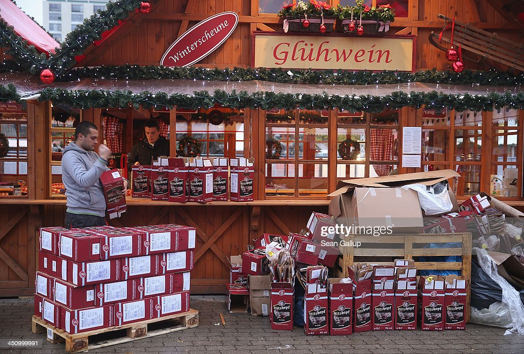 Workers open boxes of Gluehwein at a stand at a Christmas market at Alexanderplatz on November 20, 2013 in Berlin, Germany. Berlin, with still over a month to go, is preparing for Christmas.