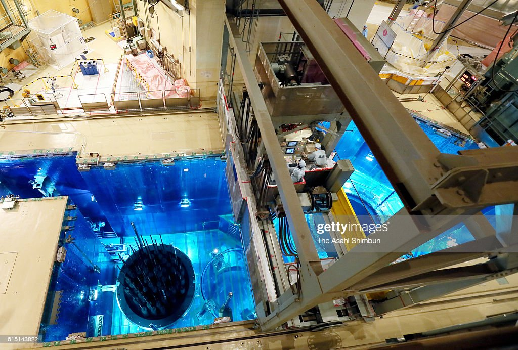 Workers operate a crane to remove nuclear fuel rod from the reactor of the first reactor during the regular check up at the Kyushu Electric Power Co's Sendai Nuclear Power Plant on October 17, 2016 in Satsumasendai, Kagoshima, Japan. The utility plans to restart the reactor after the check up in December while new Kagoshima Prefecture Governor Satoshi Mitazono, who had already requested to haul the nuclear plant immediately.