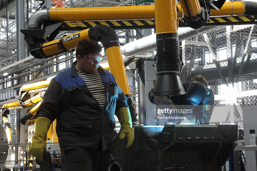 Workers operate at the Obukhov state plant during Russian President Vladmir Putin visit on June 19, 2013 in in Saint Petersburg, Russia. Putin held a meeting at the plant on the development and implementation of military services and equipment.