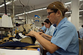 Workers operate sewing machines at the Touche factory in Medellin Colombia on Monday Aug 25 2014 Touche designs and manufactures swimwear and...