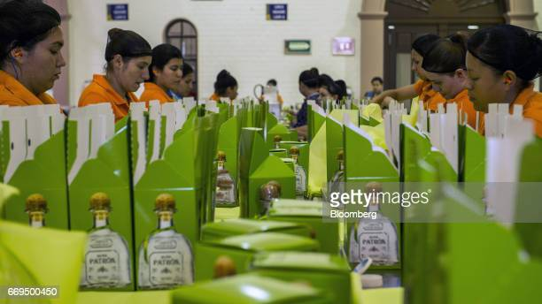 Workers package bottles of Patron Spirits Co brand Silver Tequila at the company's distillery in Atotonilco El Alto Jalisco Mexico on Tuesday April 4...