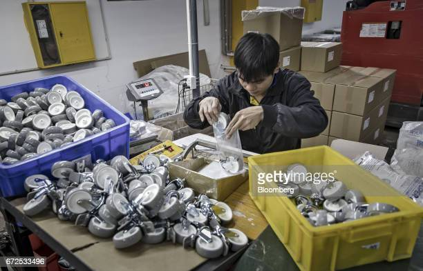 A workers packs casters into bags at a factory operated by the Guangdong Shiyi Furniture Co in Foshan China on Tuesday Feb 28 2017 Startup EDeodar a...