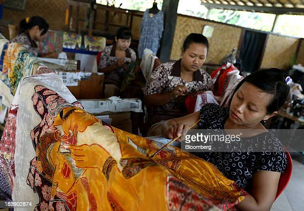 Workers paint batik cloth at a store in Gianyar Bali Indonesia on Tuesday Oct 8 2013 Bank Indonesia said it will regulate currency hedging by...