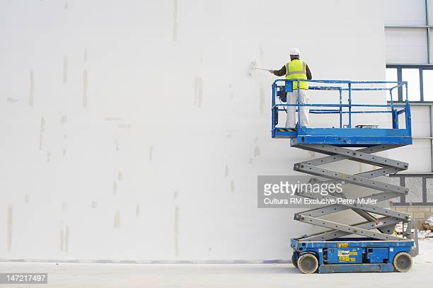 Workers painting on site