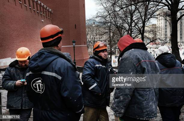 Workers pause by the Kremlin in Moscow on March 4 2017 in Moscow Russia Relations between the United States and Russia are at their lowest point in...