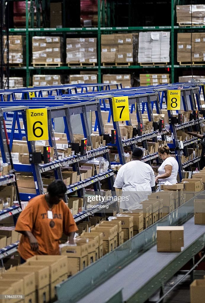 Workers pick items to fill orders at the Mary Kay Inc. regional distribution facility in Dallas, Texas, U.S., on Tuesday, Aug. 6, 2013. About 350,000 Mary Kay businesses were started globally in the past year, including 90,000 in the first quarter of 2013, according to a company press release. Photographer: T.J. Kirkpatrick/Bloomberg via Getty Images