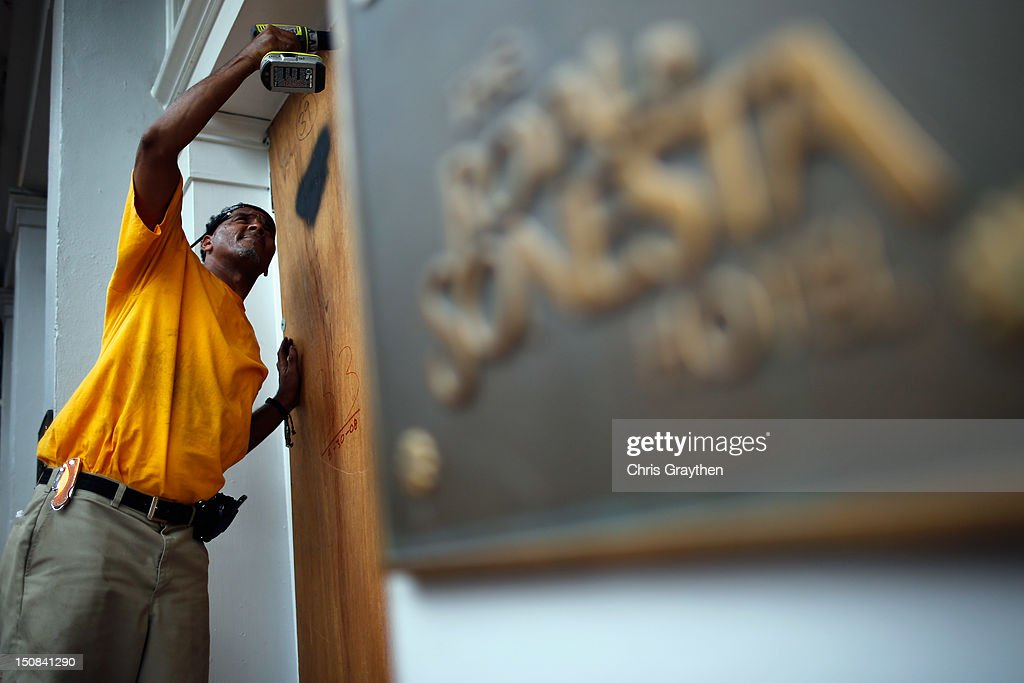 Workers place plywood on the windows of the Royal Sonesta Hotel on Bourbon St. to prepare for Tropical Storm Isaac on August 27, 2012 in New Orleans, Louisiana. Tropical Storm Isaac is expected to strengthen into at least a Category 1 hurricane before making landfall near Louisiana.