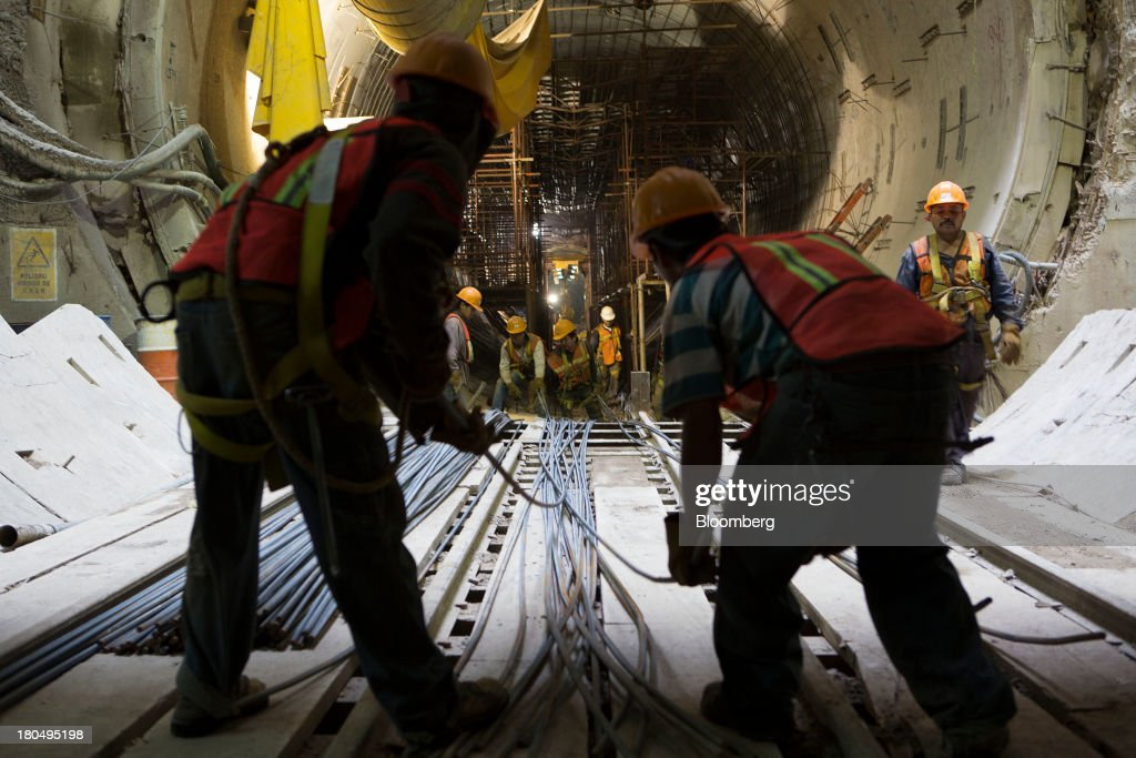 Workers place steel rods inside the Tunnel Emisor Oriente (TEO), or Eastern Discharge Tunnel, during construction of the 38 mile (62km) underground wastewater treatment tunnel in Mexico City, Mexico, on Thursday, Sept. 12, 2013. The tunnel, which is expected to be completed in 2014, will boost Mexico City's drainage capacity to help prevent flooding during rainy season and the over-exploitation of groundwater resources. The project is being managed by Mexico's National Water Commission, Conagua. Photographer: Susana Gonzalez/Bloomberg via Getty Images