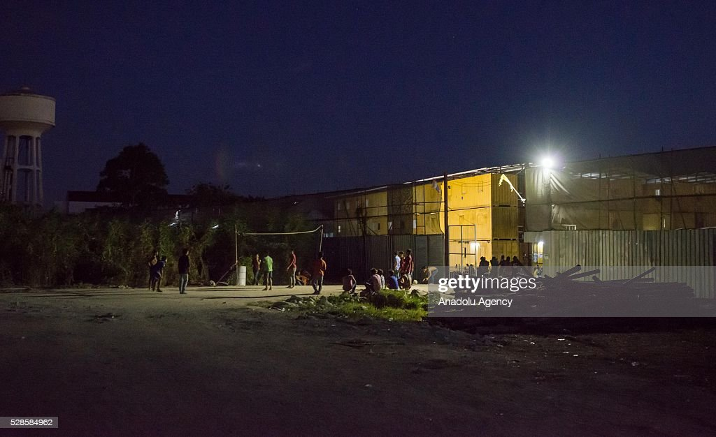 Workers play volleyball at a construction workers' camp on May 6, 2016 in Bangkok, Thailand. Mainly migrants from neighboring countries, like Cambodia and Laos, live in this camp, which has grocery shops, a common washing area and even a small school, on the outskirts of Bangkok.