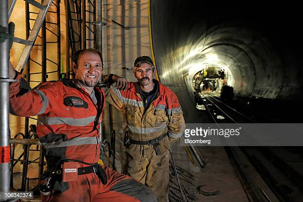 Workers pose for a photograph in the Gotthard railway tunnel in Erstfeld Switzerland on Wednesday Oct 27 2010 When completed the tunnel will be the...