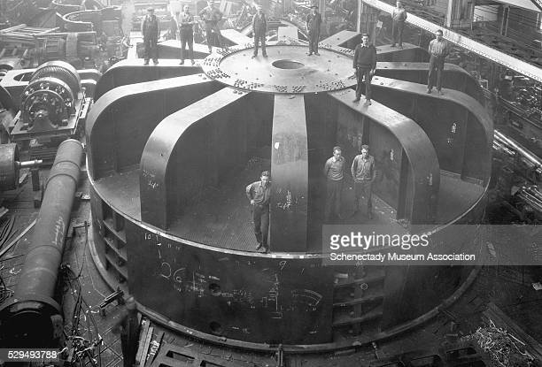 Workers pose with a Stator frame and upper bearing bracket for a 77500 kv000 hp vertical waterwheel at the Dnieper River Station