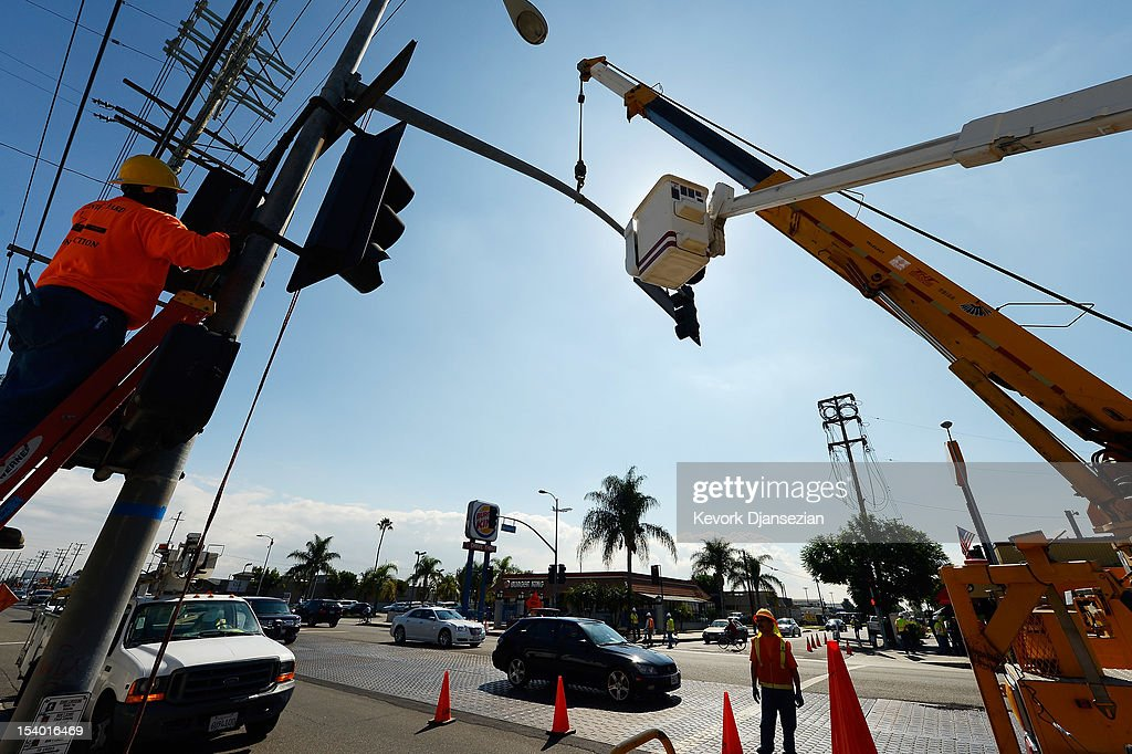 Workers preapre to bring down a street light temporarily to make room for the space shuttle Endeavour's 12-mile two-day raod trip throught the streets of Los Angeles County on October 12, 2012 in Los Angeles, California. The space shuttle Endeavour is making the journey from Los Angeles International Airport to the California Science Center to go on permanent public display. Endeavour was transported cross-country atop NASA's Shuttle Carrier Aircraft from Kennedy Space Center in Florida to LAX during its last flight ever on September 21.