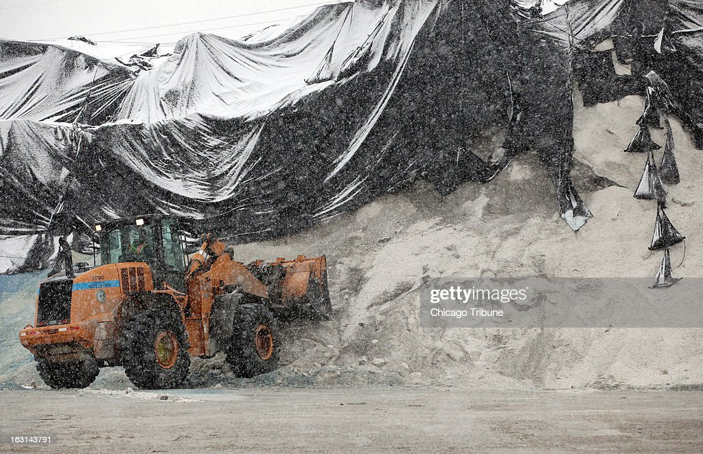 Workers prep for more trucks at the Streets and Sanitation Departments salt storage site at Grand Ave. and Rockwell as the snow continues to fall in Chicago, Tuesday, March 5, 2013.