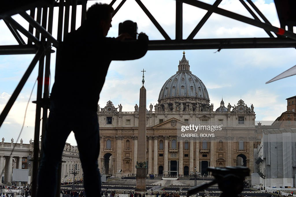Workers prepare a platform for television crews in front of St Peter's basilica on the eve of the last weekly general audience of Pope Benedict XVI on February 26, 2013 in Rome. Pope Benedict XVI issued a decree the day before allowing cardinals to bring forward a conclave to elect his successor, as the resignation of a top cardinal and deepening intrigue in the Vatican clouded the run-up to the vote.