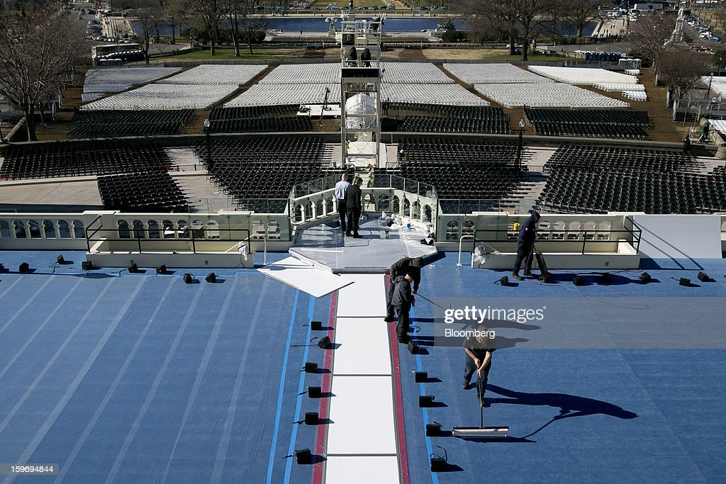 Workers prepare a platform outside the U.S. Capitol prior to the second inauguration of U.S. President Barack Obama in Washington, D.C., U.S., on Friday, Jan. 18, 2013. President Obama's second inauguration next week will combine the star power of Beyonce, Kelly Clarkson and James Taylor with a lineup that reflects social values Obama will champion in his new term. Photographer: Andrew Harrer/Bloomberg via Getty Images