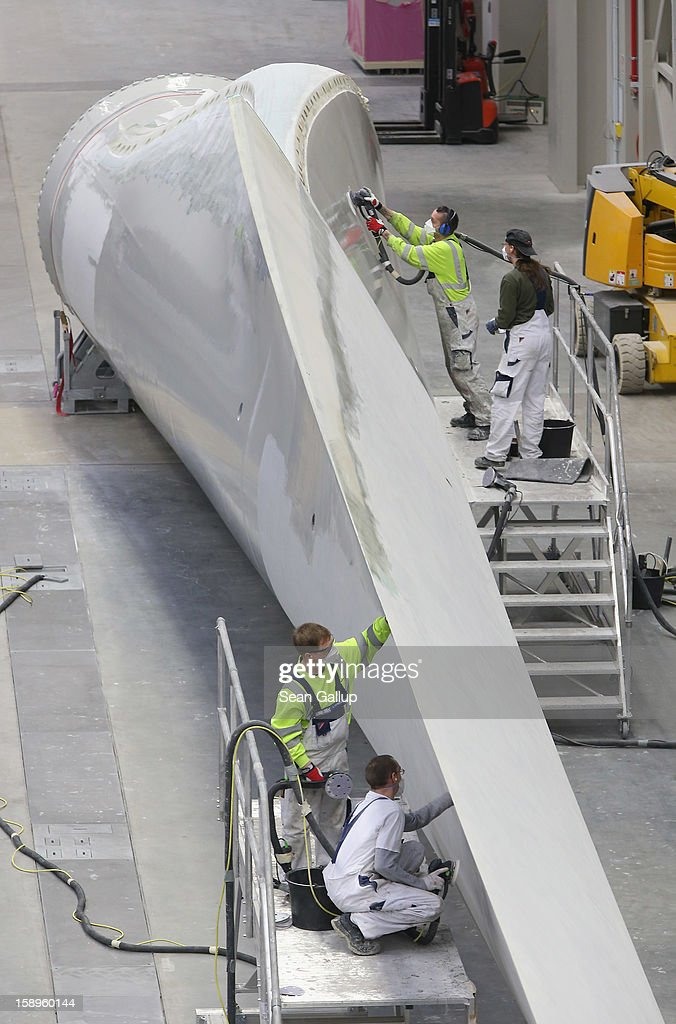 Workers prepare a rotor blade for a wind turbine at the Enercon wind turbine factory on January 4, 2013 in Aurich, Germany. Germany is invetsing heavily in alternative energy sources and has set a high priority on onshore and offshore wind farms.