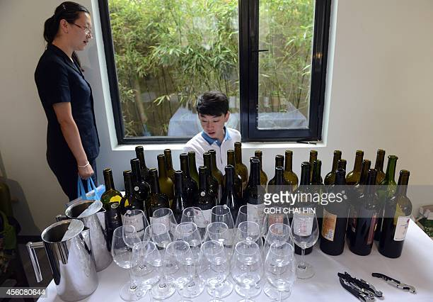 Workers prepare a selection of Ningxia wine at a large tasting event in Beijing on September 25 2014 Ningxia wine has gone from an unknown remote...