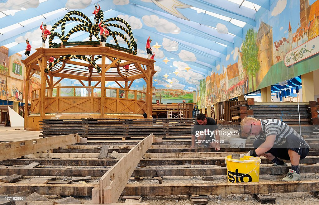 Workers prepare a tent for the 2013 Oktoberfest beer festival on August 22, 2013 in Munich, Germany. Munich Oktoberfest, which opens to the public on September 21, draws millions of visitors and is the biggest beer festival in the world.