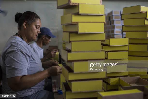 Workers prepare cigar boxes at the Quesada Cigars facility in Santiago de los Caballeros Dominican Republic on Thursday May 4 2017 The Quesada family...