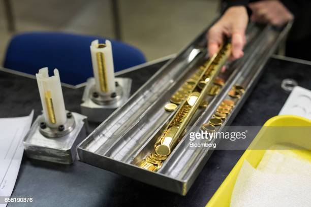 Workers prepare coin 'blanks' in the production of gold bullion coins at The Royal Mint in Llantrisant UK on Thursday March 23 2017 Britain's Royal...