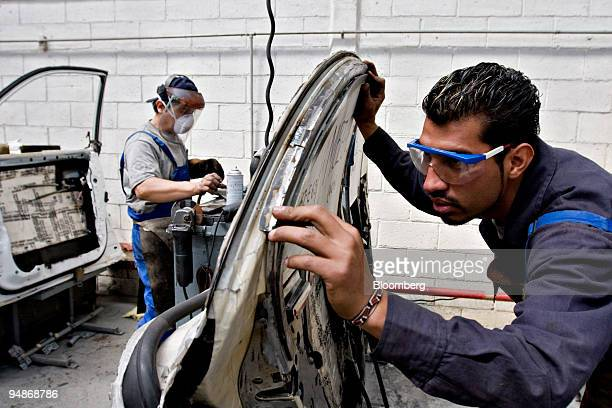 Workers prepare door panels for armor in the AutoSafe factory of Wendler Blindajes Alemanes in Mexico City Mexico on Friday Feb 22 2008 WBA with its...